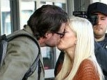Tender moment: Dean McDermott and Tori Spelling shared a kiss at LAX on Saturday