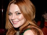 In demand: Lindsay Lohan, pictured with  Lady Victoria Hervey at Gabrielle's Gala this week, is considering moving across the pond
