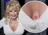 Coat Of Many Colors? Dolly Parton's breasts and arms are 'secretly covered in tattoos'