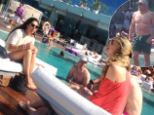 Just what would Zara say? Mike Tindall chats and laughs with women by a swimming pool in Barcelona - with his wife and baby nowhere to be seen