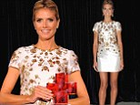 How angelic! Heidi Klum sports gold and white dress as she accepts Crystal Cross Award from American Red Cross