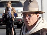 Quite the cool travellers! Johnny Depp and fiancé Amber Heard are dressed casually chic before jetting out from Boston