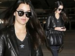 Edgy chic: Kendall Jenner jet back into LA from Cannes, France on Friday, clad in a leather fringe jacket and leggings that highlighted her model pins