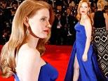 Jessica Chastain oozes old Hollywood Glamour as she arrives at Cannes in vintage waves, red lipstick and royal blue floor-length gown