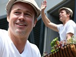 Brad Pitt shows a new bicep tattoo in New Orleans
