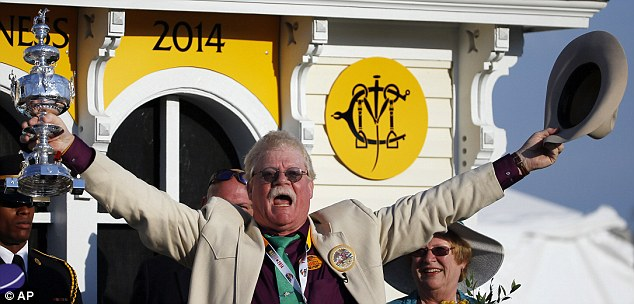 Celebrate: Co-owner of California Chrome Steven Coburn celebrates the Preakness victory at Pimlico Race Course in Baltimore, Maryland
