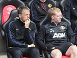 Sticking around: Phil Neville stayed on a Manchester United after David Moyes' sacking