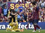 Atletico Madrid's defender Diego Godin (C) celebrates his goal