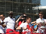 Party time! Arsenal players, including Aaron Ramsey (R), lift the trophy in front of their fans