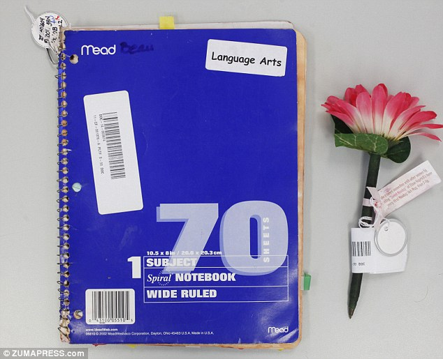 The wide-ruled, single-subject notebook - a staple of drugstore school supply aisles - belonged to Schenecker's 13-year-old son, Beau, whose name is written neatly on its cover along with the subject 'Language Arts'