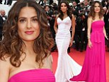Haute, haute, haute! Salma Hayek, left, dazzled in a magenta gown, as Eva Longoria, right, looked lovely in an angelic white dress, as the two attended the Saint Laurent premiere during the 67th Annual Cannes Film Festival in Cannes, France on Saturday
