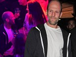 Jason Statham sports casual ensemble for Cannes night out as he is surrounded by women in French nightclub