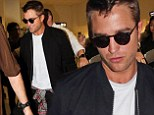 Robert Pattinson puts vampire alter-ego Edward Cullen firmly behind him as he arrives in Cannes sporting a deep tan