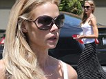 Keeping it casual: Denise Richards braved the heat in LA on Friday in a summery white tank top and a light breezy maxi skirt that highlighted her very slender frame