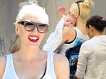 Rock-a-bye baby! Gwen Stefani affectionately carries infant Apollo during a day of mother-son bonding