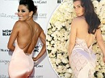 Eva Longoria borrows Kim Kardashian's famous derriere pose while stunning in skintight pale pink gown at Cannes