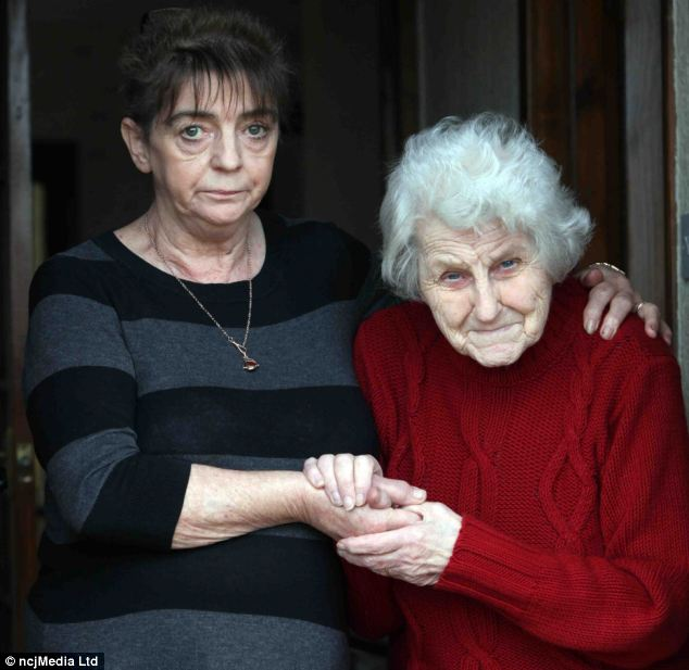 Distraught: Joseph Pringle, 64, died from heart failure in 1996 and his remains were buried in his wife Ruby's (picture, right, with Ms Robson) garden in Spittal in Berwick, Northumberland. But in November, they vanished