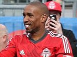 All smiles: Jermain Defoe celebrates after scoring for Toronto against New York Red Bulls on Saturday