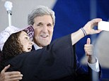 Alumni: Secretary of State John Kerry, right poses for a selfie with Yale student Ariel Kirshenbaum during Class Day at Yale University
