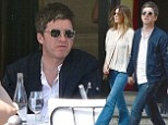 Definitely (Maybe) showing his romantic side! Noel Gallagher holds hands with wife Sara McDonald as they stroll through Paris