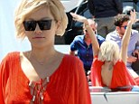 Rita Ora dances around in bright red kaftan as she spends time on Roberto Cavalli's yacht in Cannes