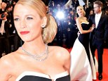 The couple that dresses together... Blake Lively wears glamorous black and white gown to Cannes premiere as Ryan Reynolds matches her in dapper tuxedo