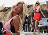 Colour-blocking on board! Victoria Silvstedt shows off trim pins in thigh-skimming pink and red dress for boat trip in Cannes