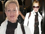 Peek-a-boo! Melanie Griffith flashes her black bra through nearly-sheer black top as she jets into LAX