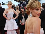 Perfecting her pose: Suki Waterhouse held onto her waist as she stood for pictures on the red carpet of The Homesman at the Palais des Festivals during the 67th Cannes Film Festival in Cannes, France on Sunday