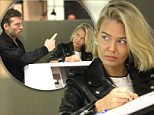 Unhappy camper: Sam Worthington looks disgruntled at the check-in counter with girlfriend Lara Bingle, pictured at Sydney airport on Sunday