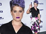 No need to call the Fashion Police! Kelly Osbourne shows off her trim figure in pretty patterned skirt and black shirt while rocking an edgy quiff