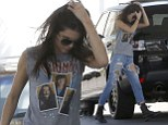 Kendall Jenner fills up her car with petrol