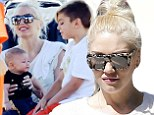 She's a soccer mom! Gwen Stefani shows off her adorable baby boy Apolo while she and Kingston watch Zuma play in a game