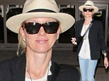 Keeping it low-key! Naomi Watts makes a casual arrival in jeans and sandals at LAX after dazzling the red carpet at Cannes