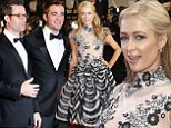 Paris Hilton tries to steal the spotlight from Robert Pattinson and Guy Pearce as she turns up to premiere of Australian film The Rover