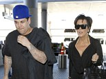 Family first: Rob Kardashian made a rare public appearance as he and mother Kris Jenner flew out for Los Angeles Airport on Sunday