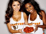 Sexual appeal: Two Hooters 'girls' hold a plate of chicken wings
