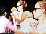 Motherly affection: Olivia Wilde puckered up for a kiss with her baby son Otis on Sunday
