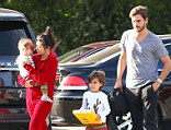 Let's hope she�s not a bridesmaid! Kourtney Kardashian sports red onesie and messy hair for family dinner... six days before Kim's wedding