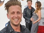 He's counting his lucky stars! Ryan Tedder beams with pride while posing next to pregnant wife at Billboard Music Awards
