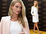 Rosie Huntington-Whiteley turns heads in thigh-skimming white dress and metallic stilettos for Magnum film screening