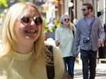 Romantic stroll: Dakota Fanning, 20, and her hunky older boyfriend 32-year-old Jamie Strachan walked hand-in-hand through New York City on Saturday