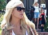 Tori Spelling puts on a brave face as she leaves her home in Encino with two of her children