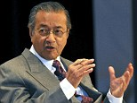 Mahathir (above, left) said the missing plane may have had its MAS airline markings removed and the Australian co-ordinated search out of Perth for debris was 'a waste of time and money'.