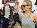 That's a bit more District 12! Jennifer Lawrence and Liam Hemsworth swap red carpet glamour for causal grey attire in Cannes