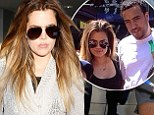 Not enough sleep? Khloe Kardashian looked rather tired and disheveled as she jet back into LAX on Friday