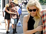 Very close: Ellie Goulding and Dougie have appeared to confirm they are dating after recent pictures show them to look more loved-up than ever before