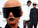 Shady lady! Amber Rose does her best futuristic robot impression on the Billboard Music Awards red carpet with husband Wiz Khalifa