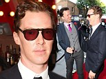Sherlock would have something to say about that! Benedict Cumberbatch keeps 1970s-style shades on inside as he arrives at Park Theatre gala