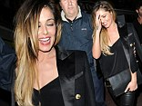 Stand Up: Cheryl Cole lets her hair down... as she is given a helping hand to her waiting car in Cannes